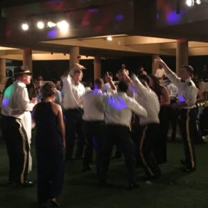 Army ball dancing in front of DJ booth