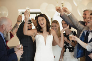 Bride raising her glass for a toast.